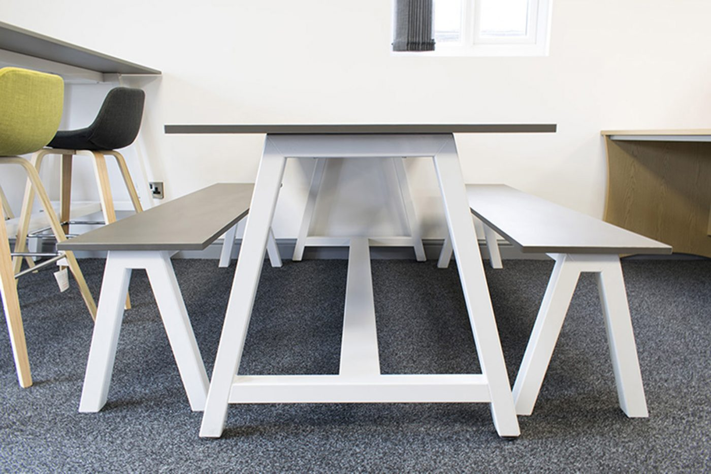 A frame table, meeting table, desk high table, breakout tables, bench seat